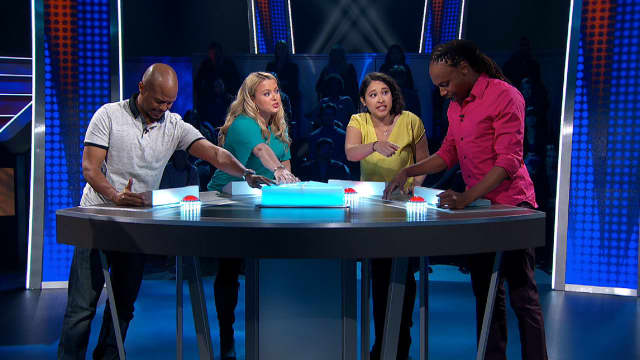 "Asya Yeliseyev of Fair Lawn, seen here in turquoise, battles it out on the Game Show Network's new show, ""Divided."""