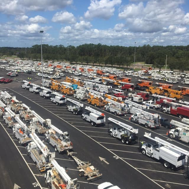 A convoy of 70 trucks from Eversource arrive Tuesday in Orlando to help restore power after Hurricane Irma.