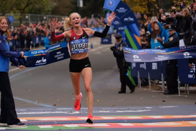 Shalane Flanagan crosses the finish line Sunday morning to win the New York City Marathon. She is the first U.S. woman to win the race in 40 years.