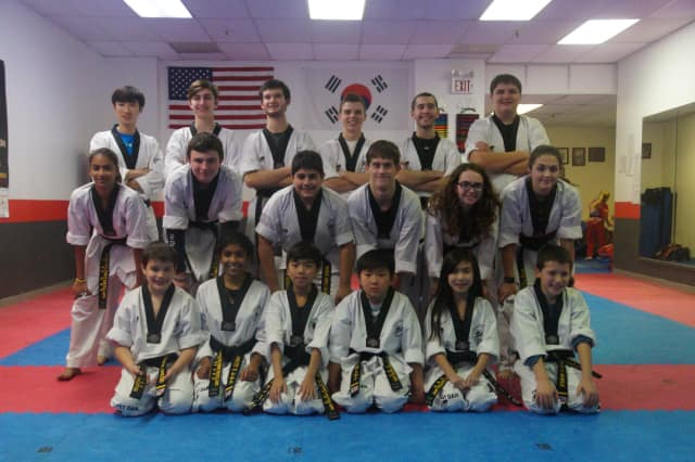 Several area students received black belts from Park Ridge Summit Martial Arts.