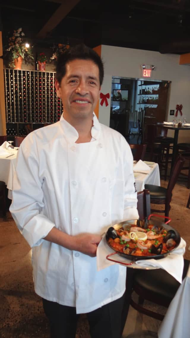Chef Daniel Lopez will offer his signature paella at Taberna's Party with a Purpose June 16.