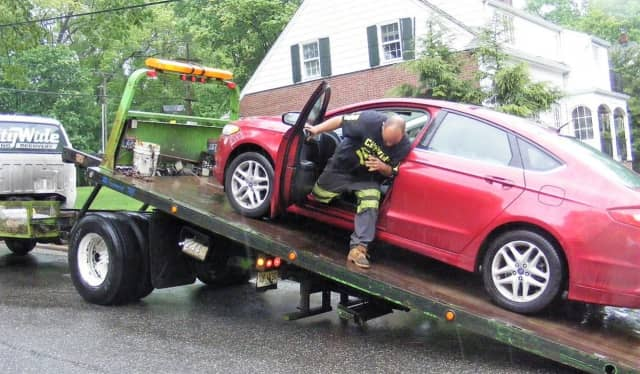 A flatbed tow truck removed the four-door Ford Fusion.