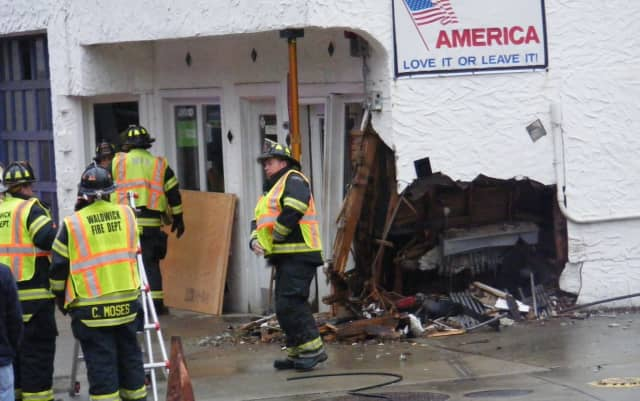 Waldwick firefighters worked to stabilize the Crescent Avenue building after the van was removed by a flatbed tow truck.