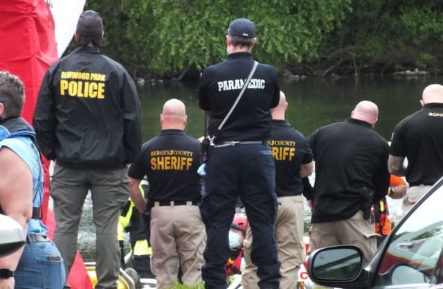At the scene of the body recovery along the Passaic River in Elmwood Park.
