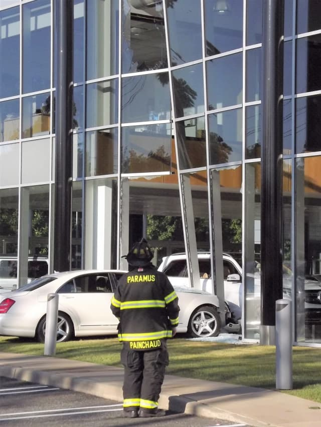 The window about 40 to 50 feet up shattered when the sedan slammed into an aluminum pillar at Prestige Motors.