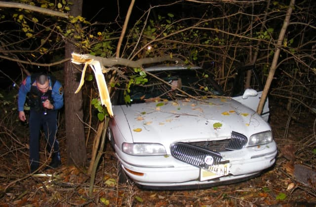 Firefighters ended up having to clear some of the wooded area to get the sedan out of the Ridgewood backyard.