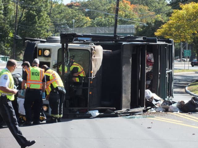 The trucker was hospitalized after the crash off Route 17 at Linwood Avenue in Ridgewood.
