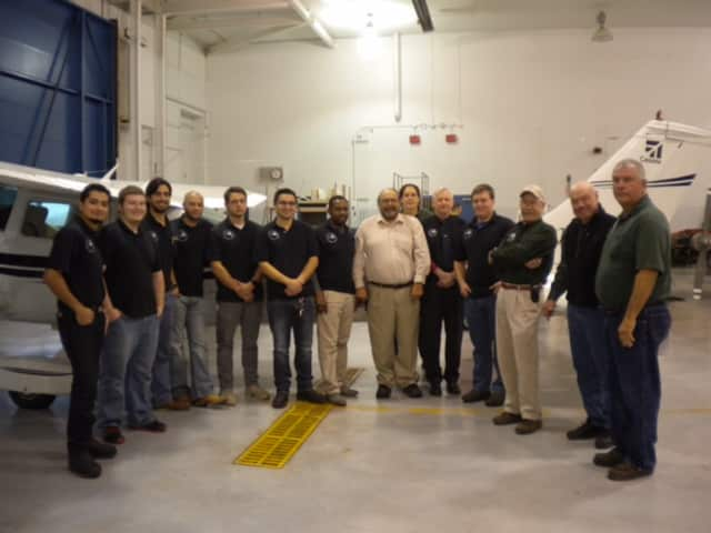 Recent graduates of the Stratford School of Aviation Maintenance Technicians.