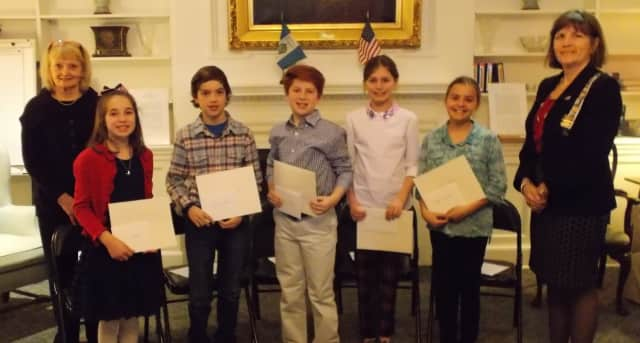 Contest Chairman Sandi MacPherson left; with First Place winner, Anne Melich; Second Place winner, L. Mercer Borden; Third Place winner, Cole Conway; Honorable Mentions Charlotte Moody and Ellen Gaaserude, with DAR Regent Katherine Love