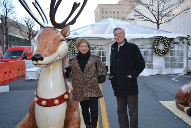From left, Paula Kelliher, Director of Marketing for The Westchester and White Plains Mayor Tom Roach with new holiday decorations on Court Street in White Plains.