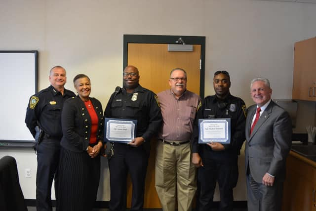 Chief Kulhawik, Commissioner Collier-Clemmons, Officer Boyd, Commissioner Yost, Officer Paulemon and Mayor Rilling