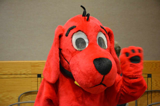 A visitor dressed as Clifford the dog attends at New Castle Town Board meeting to promote the Chappaqua Children's Book Festival.