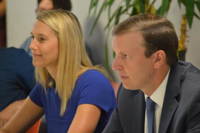 U.S. Sen. Chris Murphy listens to entrepreneurs at a roundtable discussion in Stamford Wednesday as State Rep. Caroline Simmons of Stamford looks on.