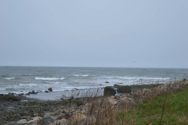 Whitecaps crashed on the shore at Stratford Point Friday.