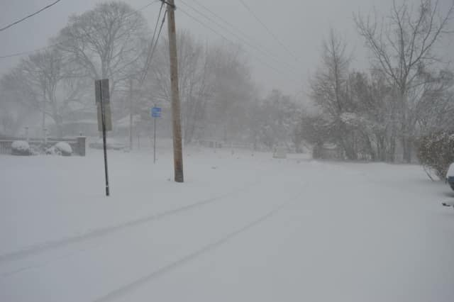 Snow was falling steadily at Hackley Street and Harbor Avenue in Bridgeport Thursday morning.