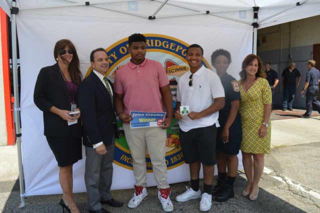Mayor Joe Ganim, second from left, presents Jalen Crawley, center, with his new iPod Shuffle.