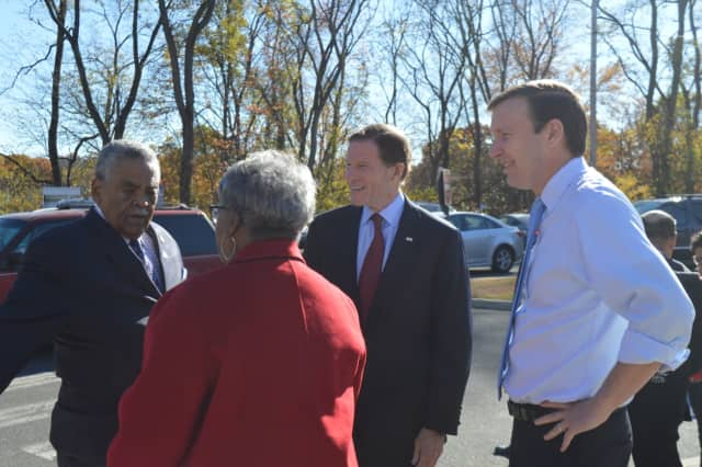 State Sens. Ed Gomes and Marilyn Moore chat with U.S. Sens. Richard Blumenthal and Chris Murphy outside Bridgeport's Wilbur Cross School during voting on Tuesday.