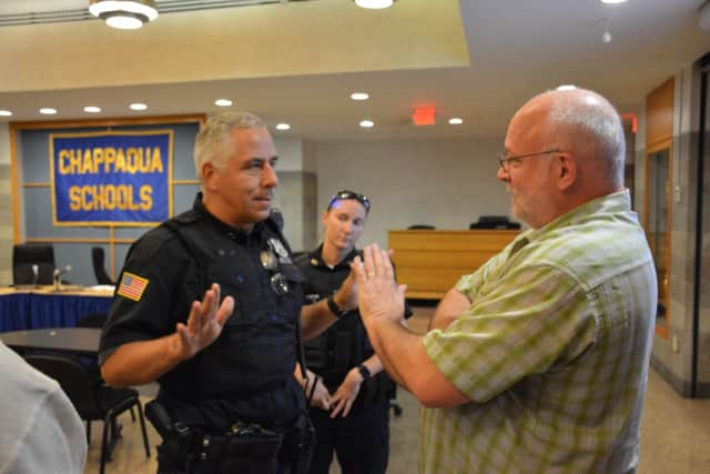 New Castle Police meet with Will Wedge following his interruption of a Chappaqua school board meeting.