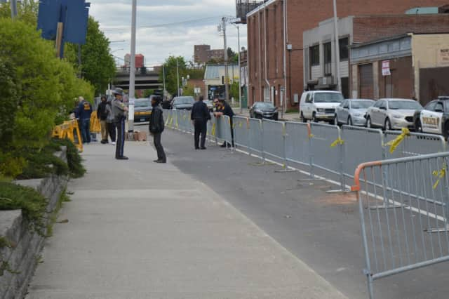 Bridgeport and State Police wait near barricades set up in the wake of an officer-involved fatal shooting earlier this month.