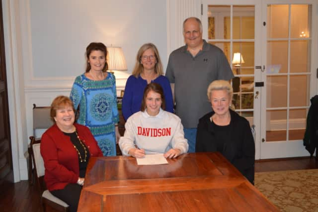 Convent of Sacred Heart Greenwich senior Tracey Hagan signs her national commitment letter Wednesday morning to join the women's soccer team at Davidson College in North Carolina.