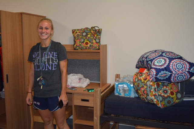 A student athlete moves into the new Elm Hall.