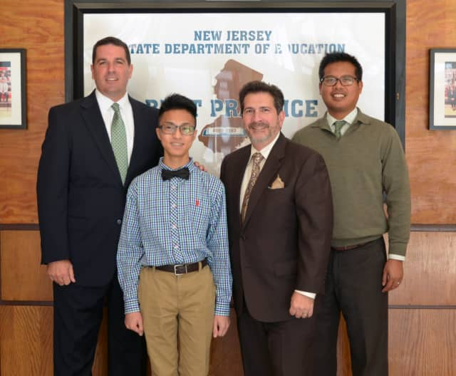 From left, Bergenfield High School Principal James Fasano, Ezra James Capiral, music teacher Joseph Dubbiosi, and Assistant Principal Robert Ragasa.