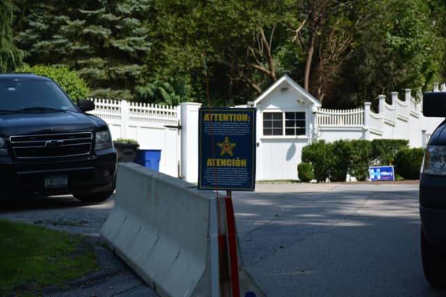 The entrance to the home of Hillary and Bill Clinton can be seen in the background at the end of Old House Lane in Chappaqua.