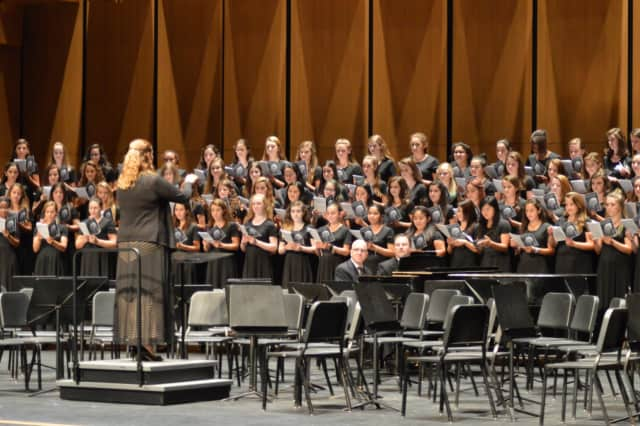 A student choral group performs at the Greenwich High School Performing Arts Center on its opening night. The school's orchestra ensemble recorded a Mozart piece in the same space, which serves as music for callers on hold to town hall.