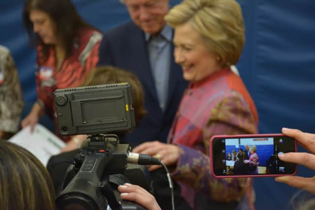 An array of cameras surround Hillary Clinton as she makes a stop at her polling place in Chappaqua to vote in the Democratic presidential primary last month.