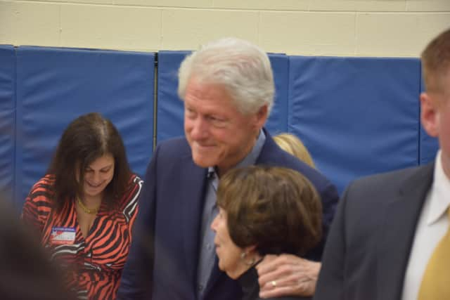 Former President Bill Clinton embraces as supporter as he and his wife, Democratic presidential candidate Hillary Clinton, visit their polling place last week in Chappaqua to vote in the New York Democratic primary.