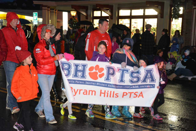 """Members of the Byram Hills PTSA march in the """"Frosty Day"""" parade in downtown Armonk."""