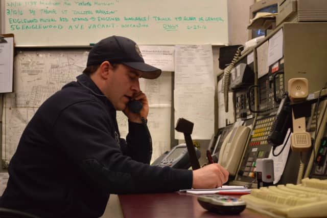 Brendan Sterbinsky, a Teaneck firefighter of five years, calls seniors in the morning to check that they are okay.