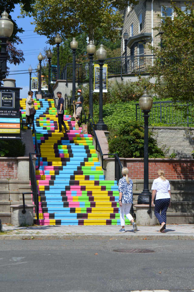 "Downtown denizens enjoy the ""Painted Staircase"" in Bridgeport."