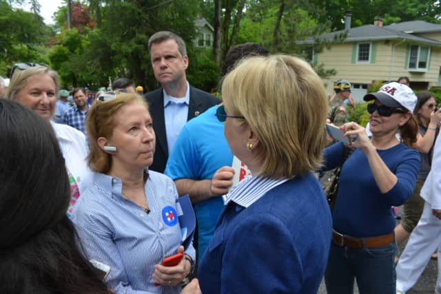 Hillary Clinton meets with a supporter in Chappaqua moments prior to the start of the 2016 Memorial Day parade. Area Democrats welcomed news this week that Clinton is their presumptive nominee for president.