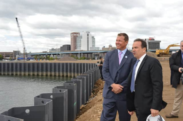 Robert Christoph Jr. of Bridgeport Landing Development and Bridgeport Mayor Joe Ganim survey the waterfront from Steelpointe Harbor in spring.