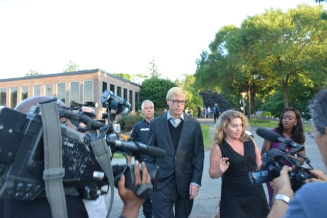 Christopher Schraufnagel and his attorney, Stacey Richman, are surrounded by a media scrum as they leave New Castle Justice Court in downtown Chappaqua on July 14.