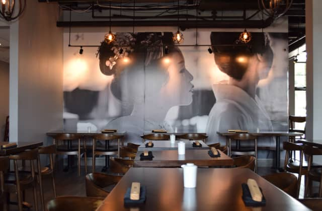 A floor-to-ceiling black-and-white photograph is the focal point of the sleek restaurant. Photographs by Aleesia Forni.