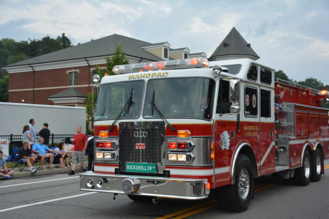A Mahopac firetruck is driven through the fire department's dress parade.