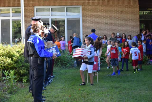 Students at Buchanan-Verplanck Elementary School presented gift boxes to representatives from local police, fire and EMT departments.