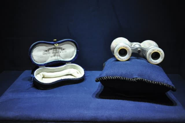 """A pair of elegant binoculars with mother of pearl detailing etched with """"Shreve, Crump & Low, Boston."""" Photograph by Meghan McSharry."""