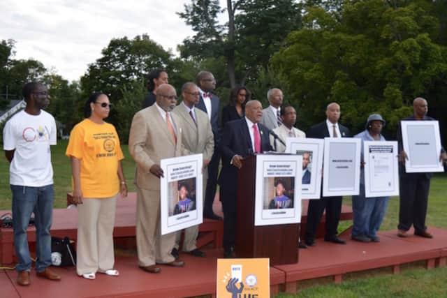 """Members of the state and Norwalk chapters of the NAACP at a press conference in August announcing a new investigation into the death of Redding lawyer Gugsa Abraham """"Abe"""" Dabela, who died last year in Redding."""