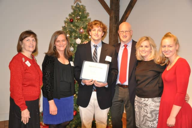 Connor Henry, accompanied by his parents Greg and Annie and sister Brittany, is presented the DAR Good Citizen Award by DAR Regent Katherine Love and DAR Good Citizen Award Chairman Kim Kiner