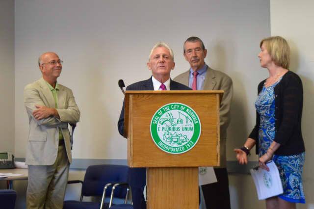 Harry Carey, Mayor Harry Rilling, Brian Baxendale and Economic Development Director Elizabeth Stocker announce Norwalk's new Economic Development Action Plan