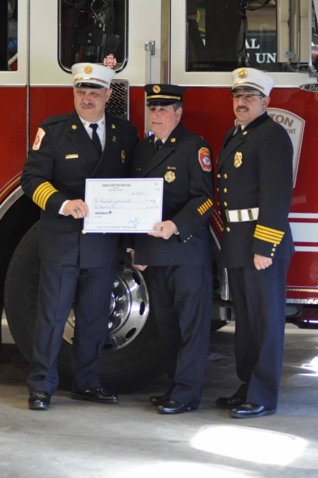 Ronald Kanterman accepted a $4,000 donation on behalf of the National Fallen Firefighters Association during a ceremony at fire headquarters Wednesday.