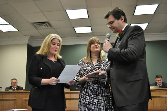 Assemblywoman Holly Schepisi swore in new Hillsdale council member Scott Karcich.