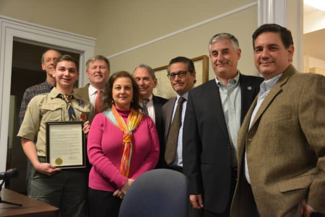 Local Eagle Scout Steven Palmesi (second from left) poses for photos with Lewisboro Town Board members. Also present are parents Lisa (center) and Tony (right).