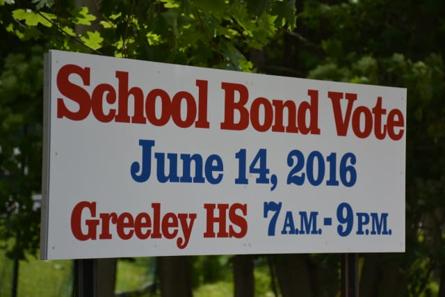 Signage in downtown Chappaqua notes voting information for the $42.5 million bond package.