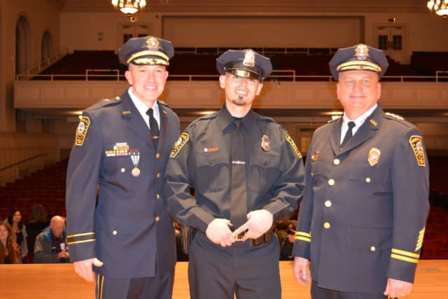 Deputy Chief James Walsh, Officer Julio Rodriguez and Chief Thomas Kulhawik