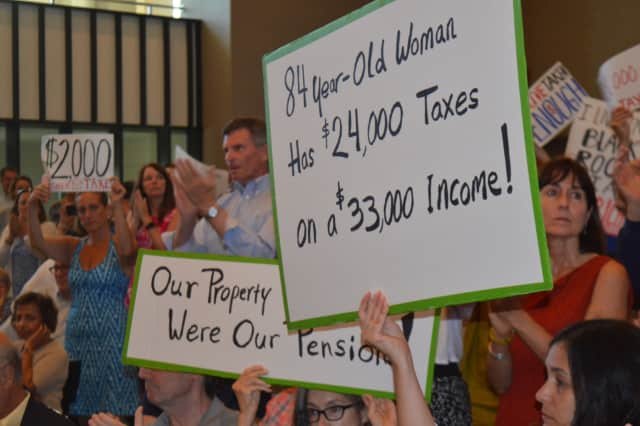 About 300 people storm Bridgeport City Hall last summer to speak their minds about a property tax hike in Bridgeport.