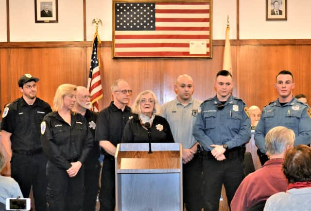(From left) Valley Paramedics Matt Bremy and Ingrid Santucci, USR Ambulance Corps Members  Erik Van Den Berg, Chad Skier and Beverly Van Den Berg, USR Police Dispatcher Greg Pink and Officers Kevin McWilliams and Colin Gurney.